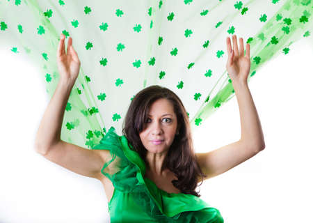 Pretty Brunette Woman in Green and a shower of Shamrocks photo