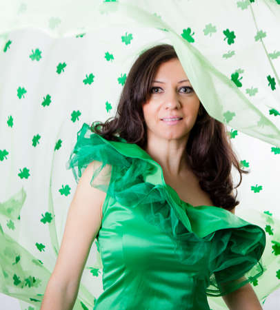 Pretty Brunette Woman in Green and a shower of Shamrocks Stock Photo - 18122760