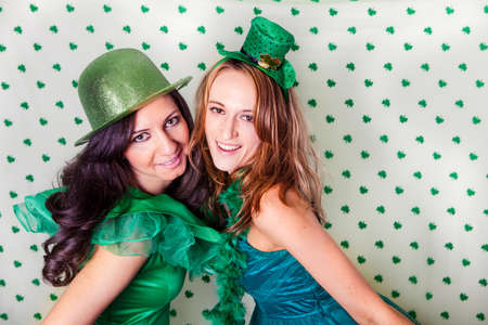 Pretty Irish women in Green and a shower of Shamrocks Stock Photo - 18122772