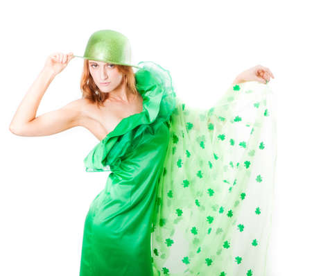 Pretty Blonde Irish Woman in Green and a shower of Shamrocks in March for St Patrick Stock Photo - 18239590