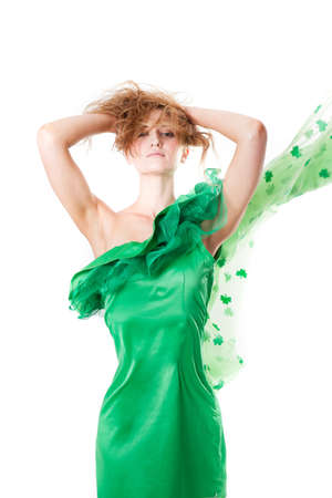 Pretty Blonde Irish Woman in Green and a shower of Shamrocks in March for St Patrick Stock Photo - 18184274