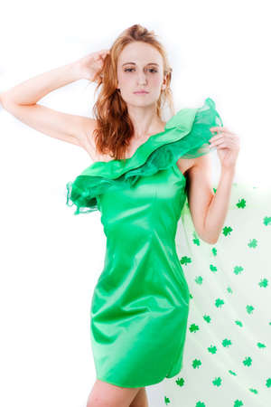 Pretty Blonde Irish Woman in Green and a shower of Shamrocks in March for St Patrick photo