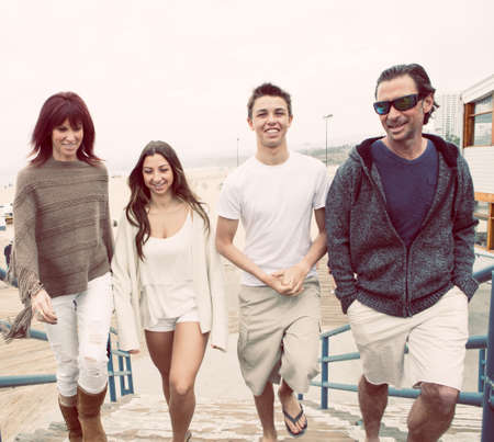 Attractive Family walking up to the pier in Santa Monica California