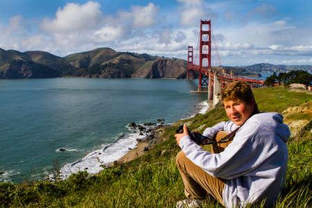cute teen boy: Cute Teen Boy in San Francisco with Golden Gate Bridge in the Background