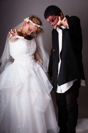 Zombie Bride and groom full Makeup on their wedding day photo