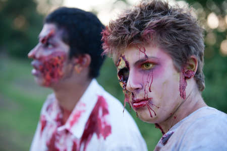 Zombie teens outside with yellow eyes looking at camera photo