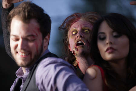 Zombie attacking a couple photo