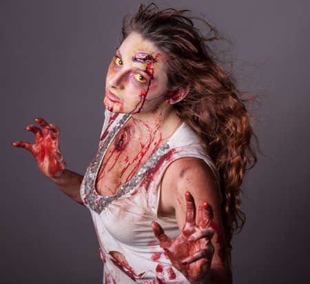 creates: Special effects artist creates Zombie woman eyes looking at camera