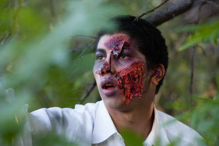 scarry: African American Teenager Zombie in the park