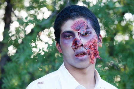 African American Teenager Zombie in the park photo