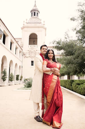 Gorgeous Indian bride and groom in front of the church photo