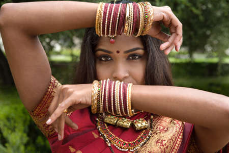 Bangles in the air Beautiful Jeweled Indian Dancer photo