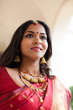 jewelery: Beautiful Indian Bride in Cathedral Hallway on her wedding day Stock Photo
