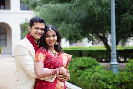 indian couple: Gorgeous Indian bride and groom looking at camera