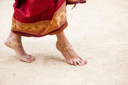 Pretty Jeweled Dancers feet in the sand photo