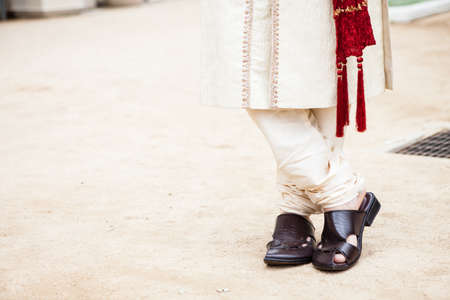 tassles: Detail picture of Shoes and feet of a Indian Groom Stock Photo