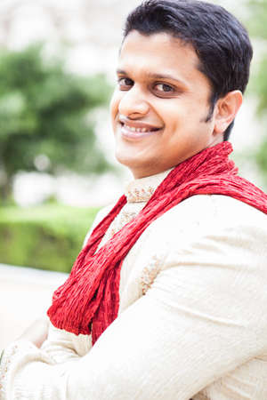 Attractive Indian groom in  traditional attire at wedding