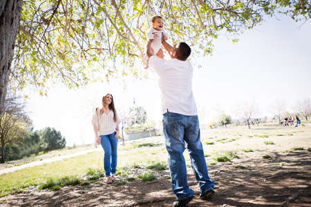 Cherry Blossoms surround a Beautiful young family in Spring time photo