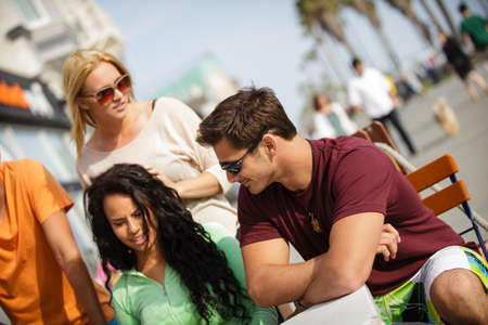 20 year old: Attractive group of 20 year old Friends on the Venice California Boardwalk at a Bistro Stock Photo