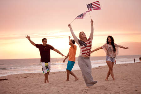 4th of july: Group of Friends in their twenties dancing on the Beach