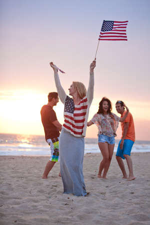 july: Group of Friends in their twenties dancing on the Beach