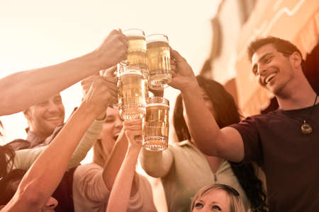 beer drinking: Group of Attractive young People toasting with a delicious Pale Ale  Beer