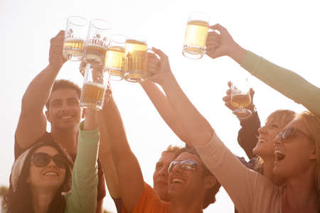 cheers: Group of Attractive young People toasting with a delicious Beer