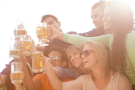 young adults: Young People in their twenties on the Venice Beach boardwalk in California drinking beer Stock Photo