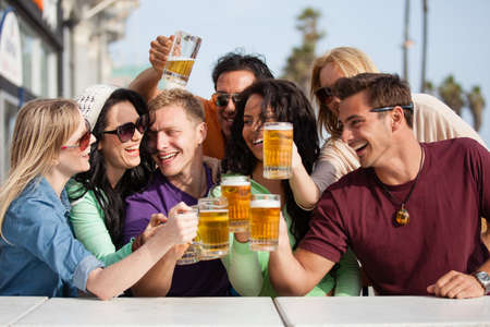 after the party: Young People in their twenties on the Venice Beach boardwalk in California drinking beer Stock Photo