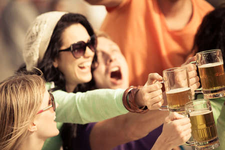 after the party: Attractive young woman drinking a beer on a beautiful sunny day with friends