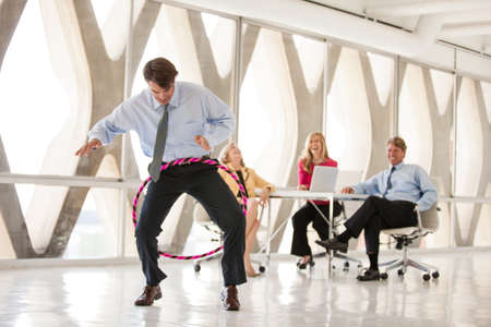 Group of Mature Adults taking a play Break in a modern office to get ideas flowing photo