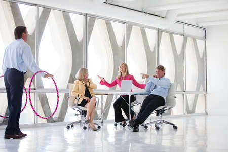 Group of Mature Adults taking a play Break in a modern office to get ideas flowing Stock Photo