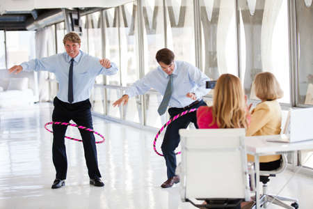 taking video: Group of Mature Adults taking a play Break in a modern office to get ideas flowing Stock Photo
