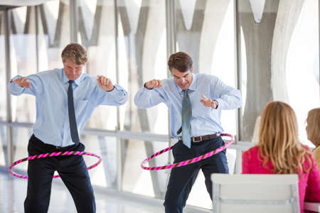 office break: Group of Mature Adults taking a play Break in a modern office to get ideas flowing Stock Photo