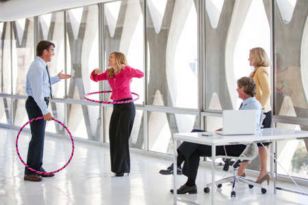 initiative: Group of Mature Adults taking a play Break in a modern office to get ideas flowing Stock Photo