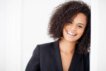 Pretty business woman smiling at camera with closeup Standard-Bild