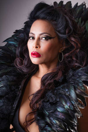 Beautiful  woman with Feathers and perfect red lips Reklamní fotografie
