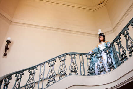 Portrait of a beautiful  woman with elaborate Marie Antoinette dress on a Balcony photo