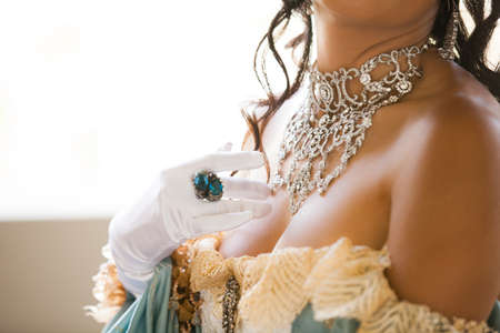lacey: Cropped portrait of a beautiful  woman with elaborate Jewelry and a Lacey Dress