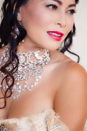 lacey: Beautiful  woman with elaborate Jewelry and a Lacey Dress