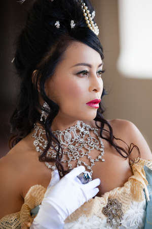 Beautiful  woman with elaborate Jewelry and a Lacey Dress photo