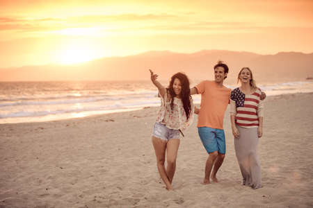 union beach: Group of Friends in their 20s Venice Beach at Sunset in Summer