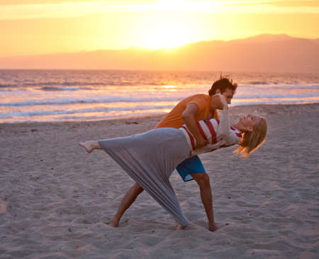 union beach: Young couple dancing on the Beach at Sunset on 4th of July Stock Photo