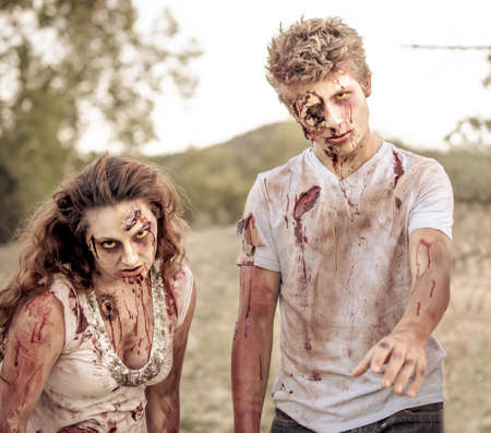 Zombies looking at camera with Bloody torn clothing