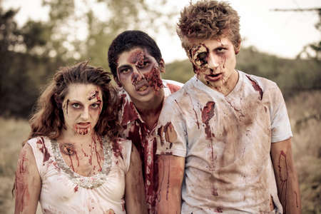 Zombies looking at camera with Bloody torn clothing photo