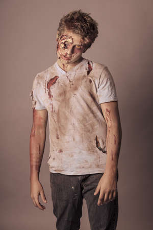 Sneering Teenager Zombie in torn bloody shirt