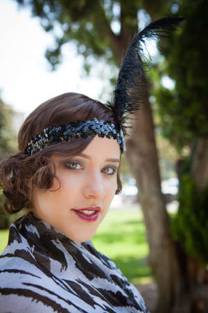Beautiful brunette in 1920s era of fashion The Flapper Stock Photo - 20760155