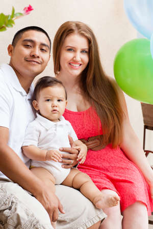 Happy young Family on Babies first Birthday Stock Photo