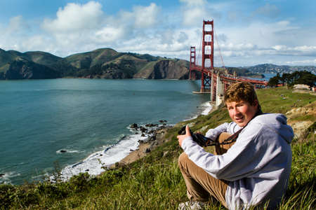 Cute Teen Boy in San Francisco with Golden Gate Bridge in the Background
