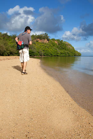 Attractive man in his fifties Hiking Kauai Beach photo